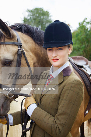 Woman in Riding Outfit with Horse Stock Photo - Rights-Managed, Image code: 822-07840876