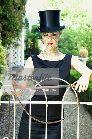 Young Woman in Top Hat and Veil Holding Riding Crop Stock Photo - Rights-Managed, Image code: 822-07840884