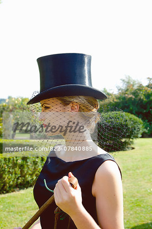 Profile of Young Woman in Top Hat and Veil Holding Riding Crop Stock Photo - Rights-Managed, Image code: 822-07840885