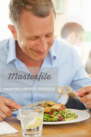 Mature Man Eating Lunch at Restaurant Smiling Stock Photo - Rights-Managed, Image code: 822-08122514