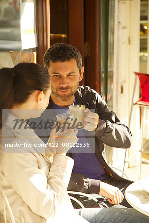 Couple at Outdoor Cafe Having Coffee Stock Photo - Rights-Managed, Image code: 822-08122536