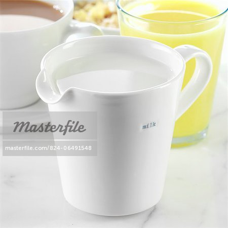 A Jug of Milk with Tea and Juice Stock Photo - Rights-Managed, Image code: 824-06491548