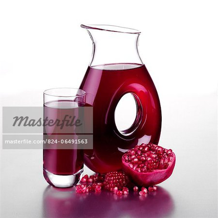 Jug of Pomegranate Juice with Halved Fruit and a Full Glass Stock Photo - Rights-Managed, Image code: 824-06491563