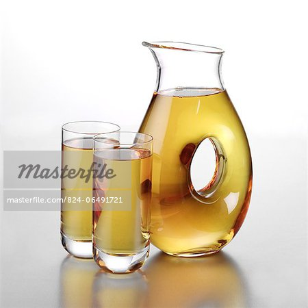 Jug of Apple Juice with Two Full Glasses Stock Photo - Rights-Managed, Image code: 824-06491721
