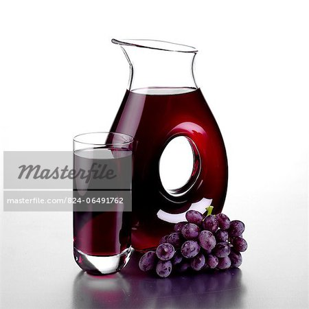Jug of Grape Juice, a Full Glass and a Bunch of Grapes Stock Photo - Rights-Managed, Image code: 824-06491762