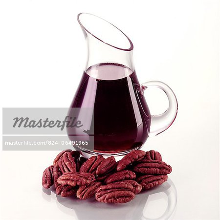 Dark Maple Syrup with Pecans Stock Photo - Rights-Managed, Image code: 824-06491965