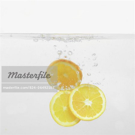 Orange Slices splashing into water Stock Photo - Rights-Managed, Image code: 824-06492107