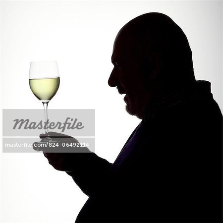 Silhouette Portrait of a man enjoying a glass of white wine Stock Photo - Rights-Managed, Image code: 824-06492114