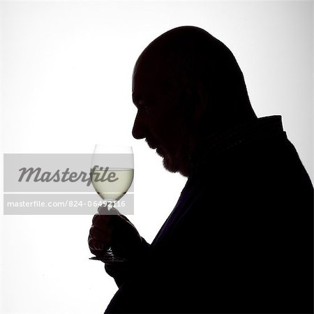 Silhouette Portrait of a man enjoying a glass of white wine Stock Photo - Rights-Managed, Image code: 824-06492116