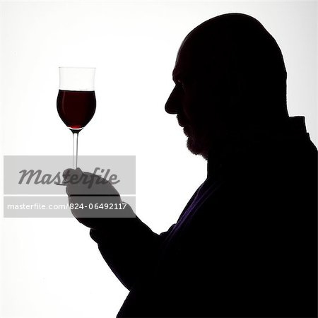 Silhouette Portrait of a Man enjoying a glass of red wine Stock Photo - Rights-Managed, Image code: 824-06492117