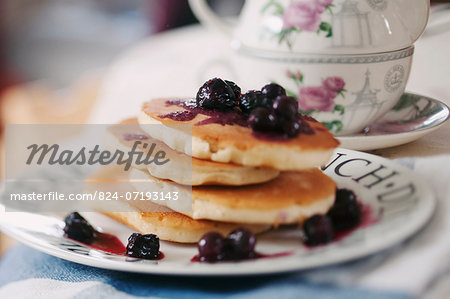 Blueberry Pancakes on a china plate Stock Photo - Rights-Managed, Image code: 824-07193143