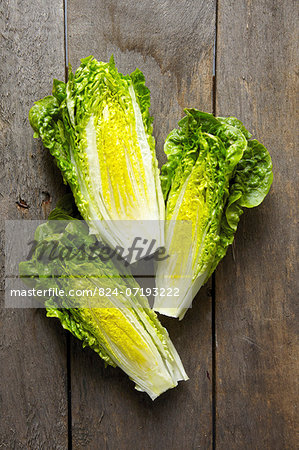 Little Gem Lettuce On Wooden Background Stock Photo - Rights-Managed, Image code: 824-07193222