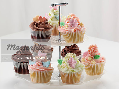 Iced cupcakes on a cake stand Stock Photo - Rights-Managed, Image code: 824-07194203