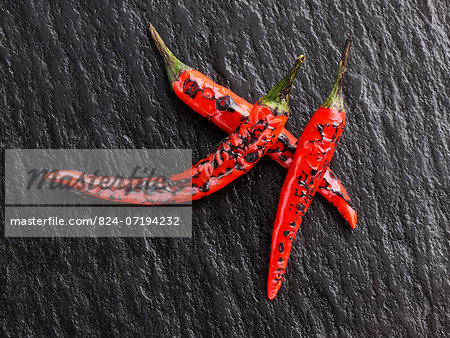 Flamed red chili peppers chillies Stock Photo - Rights-Managed, Image code: 824-07194232