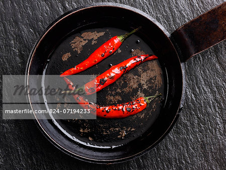 Flamed red chili peppers chillies Stock Photo - Rights-Managed, Image code: 824-07194233