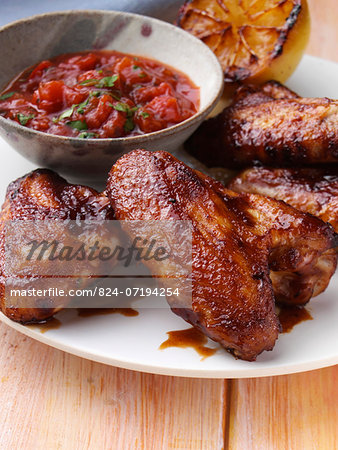 BBQ Chicken wings with tomato salsa Stock Photo - Rights-Managed, Image code: 824-07194254