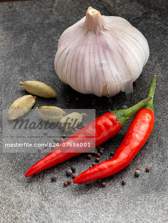 Garlic chillies cardamoms onion seeds Stock Photo - Rights-Managed, Image code: 824-07586001