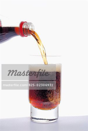 Pouring coca cola into a glass