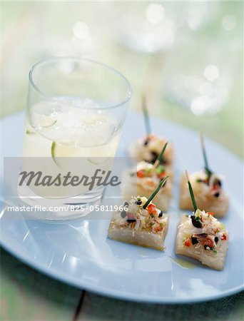 Margarita cocktail with fish canapés Stock Photo - Rights-Managed, Image code: 825-05811966