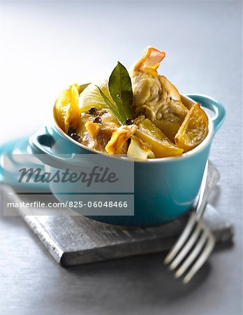 Casserole dish of rabbit with confit citrus,fennel and bay leaves Stock Photo - Rights-Managed, Image code: 825-06048466