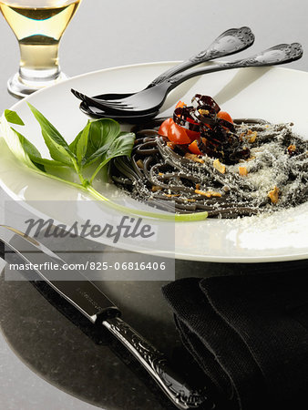 Squid ink spaghetti with purple peppers Stock Photo - Rights-Managed, Image code: 825-06816406
