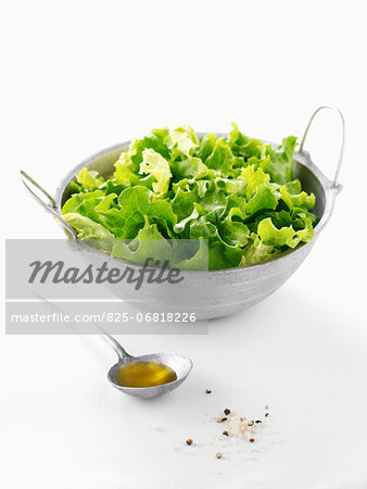 Lettuce salad with a spoonful of olive oil Stock Photo - Rights-Managed, Image code: 825-06818226