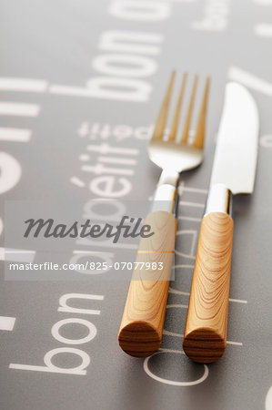 "Knife and fork on a table with the inscription ""Bon appetit"" Stock Photo - Rights-Managed, Image code: 825-07077983"