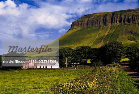 Ben Bulben, Co Sligo, Ireland, Cottage below a large rock formation Stock Photo - Rights-Managed, Image code: 832-03233364