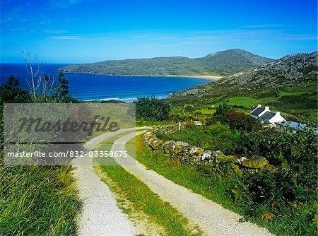Dirt road passing through a landscape, Rosguill Peninsula, Tranarossan Bay, County Donegal, Republic Of Ireland Stock Photo - Rights-Managed, Image code: 832-03358675
