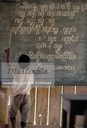 Boy pointing at writing on a blackboard in a rural school Stock Photo - Rights-Managed, Image code: 832-03724424