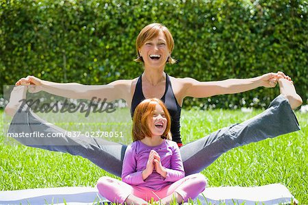 Portrait of a mid adult woman with her daughter practicing yoga Stock Photo - Rights-Managed, Image code: 837-02378051