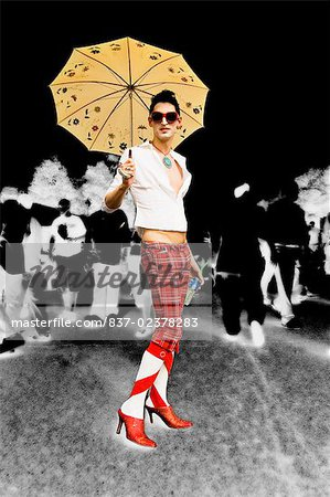 Gay man holding an umbrella and smiling Stock Photo - Rights-Managed, Image code: 837-02378283