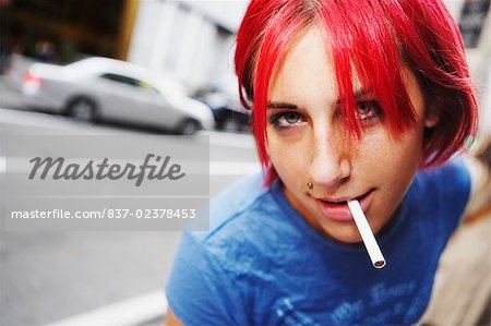 Portrait of a young woman smoking a cigarette Stock Photo - Rights-Managed, Image code: 837-02378453