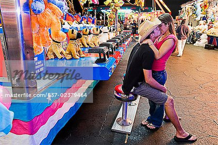 Teenage couple kissing each other in an amusement park Stock Photo - Rights-Managed, Image code: 837-02379464