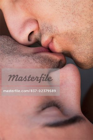 Close-up of a gay couple kissing each other Stock Photo - Rights-Managed, Image code: 837-02379589