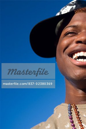Close-up of a gay man smiling Stock Photo - Rights-Managed, Image code: 837-02380369