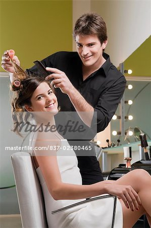 Portrait of a hairdresser adjusting the hair of a young woman Stock Photo - Rights-Managed, Image code: 837-02380465