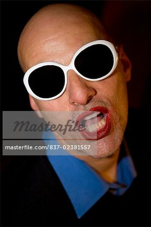 Close-up of a gay man wearing sunglasses Stock Photo - Rights-Managed, Image code: 837-02381557