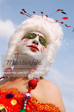 Low angle view of a gay man with face paint on his face Stock Photo - Rights-Managed, Image code: 837-02381910