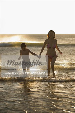 Woman running with her son on the beach Stock Photo - Rights-Managed, Image code: 837-03069635