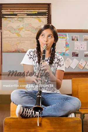 Schoolgirl playing a clarinet in a classroom Stock Photo - Rights-Managed, Image code: 837-03069638