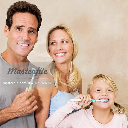Family brushing teeth in the bathroom Stock Photo - Rights-Managed, Image code: 837-03069773