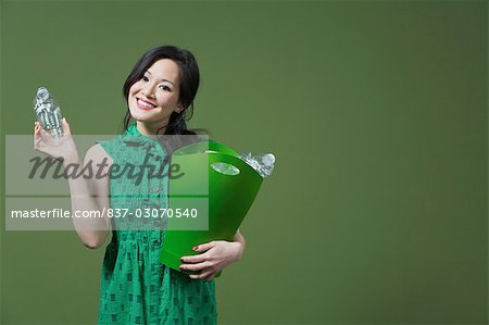 Portrait of a woman holding a recycling bin Stock Photo - Rights-Managed, Image code: 837-03070540