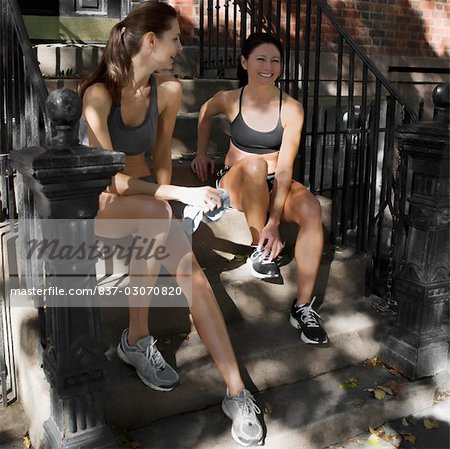 Two women sitting on steps and smiling Stock Photo - Rights-Managed, Image code: 837-03070820