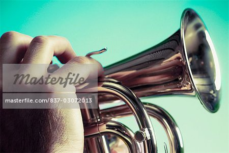 Close-up of a man blowing a bugle Stock Photo - Rights-Managed, Image code: 837-03072013