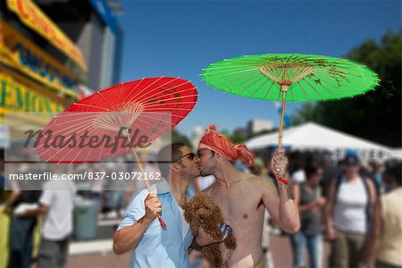 Gay couple holding parasols and kissing each other,DuPont Circle,Washington DC,USA Stock Photo - Rights-Managed, Image code: 837-03072162