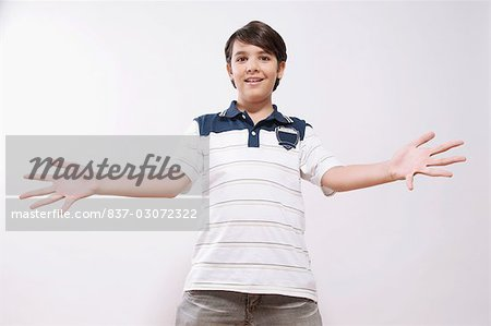 Portrait of a boy showing his palm out Stock Photo - Rights-Managed, Image code: 837-03072322