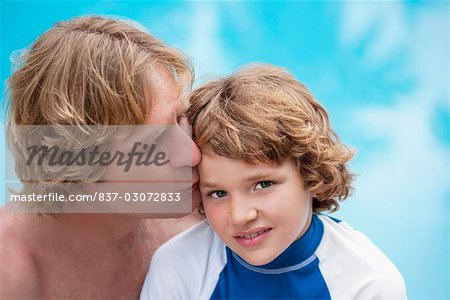 Man kissing his son at the poolside Stock Photo - Rights-Managed, Image code: 837-03072833