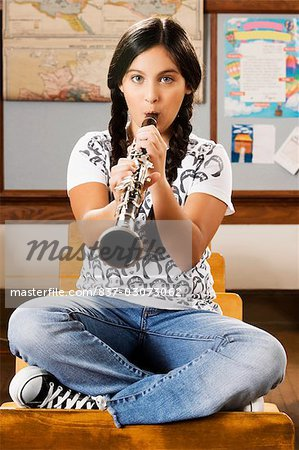 Schoolgirl playing a clarinet in a classroom Stock Photo - Rights-Managed, Image code: 837-03073062