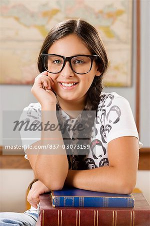 Schoolgirl smiling in a classroom Stock Photo - Rights-Managed, Image code: 837-03073159